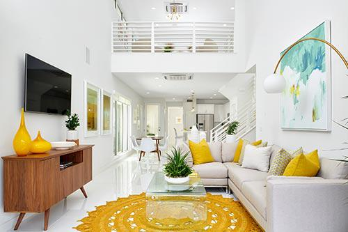 living room in the Plan One at The QUE by Woodbridge Pacific Group