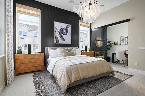 vertical tongue and groove gray paneling in bedroom by Chameleon Design