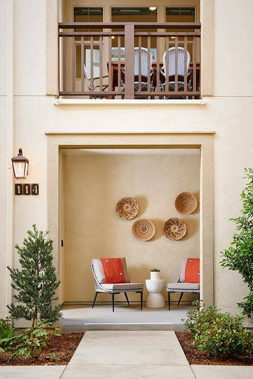 outdoor chairs and table on porch by Chameleon Design